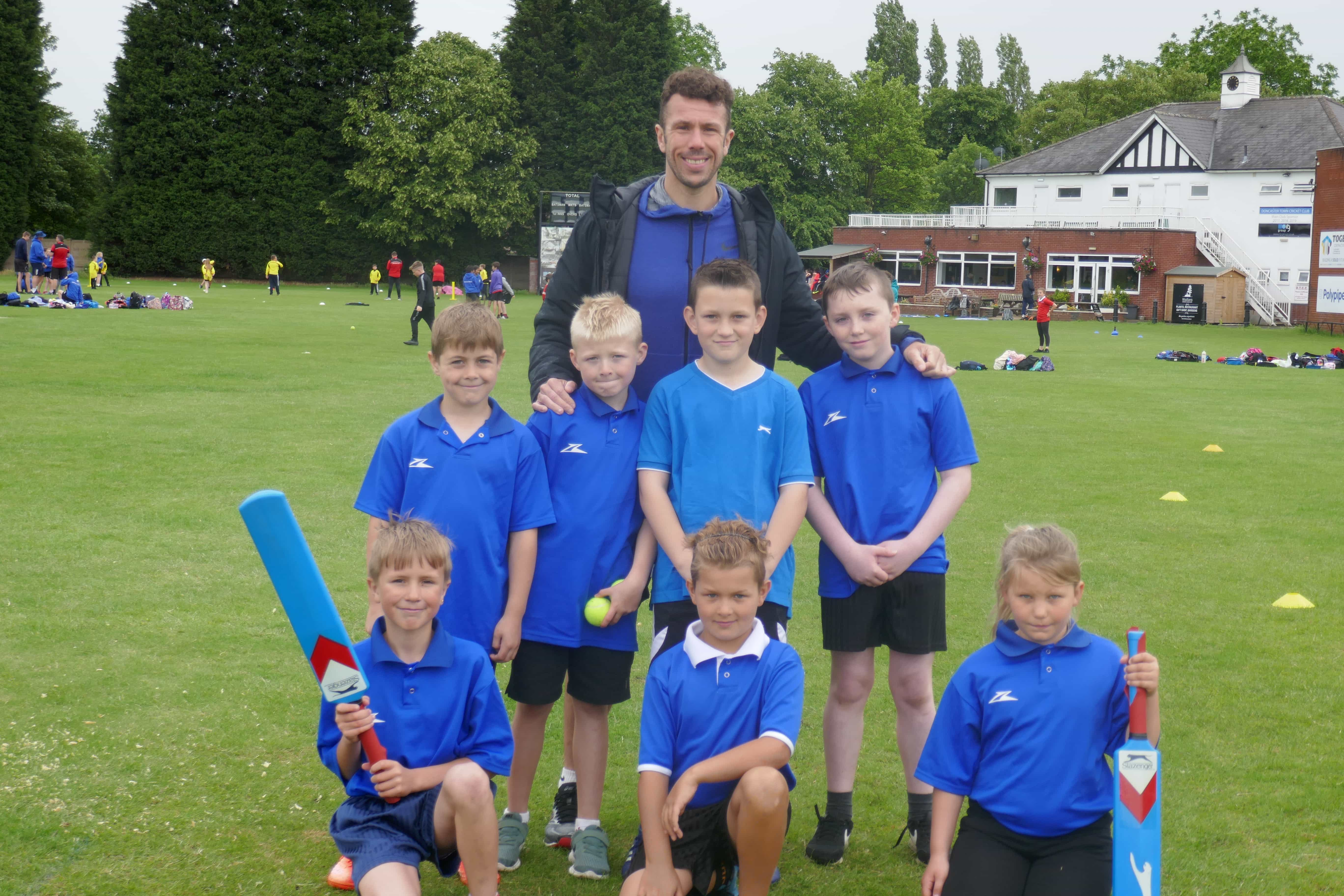 Brad Johnston with students at another School Games event
